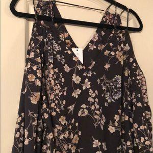 Beautiful detailed cut out peek shoulder blouse
